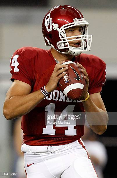 Quarterback Sam Bradford of the Oklahoma Sooners drops back to pass against the Brigham Young Cougars at Cowboys Stadium on September 5 2009 in...