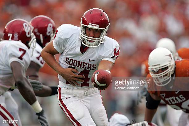 Quarterback Sam Bradford of the Oklahoma Sooners hands the ball off during play against the Texas Longhorns at the Cotton Bowl October 6, 2007 in...