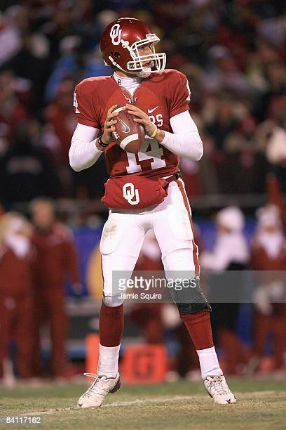 Quarterback Sam Bradford of the Oklahoma Sooners looks to pass the ball during the Big 12 Championship game against the Missouri Tigers on December 6...