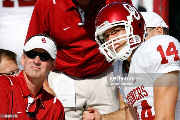 Quarterback Sam Bradford of the Oklahoma Sooners on the sidelines after an injury during play against the Texas Longhorns at Cotton Bowl on October...