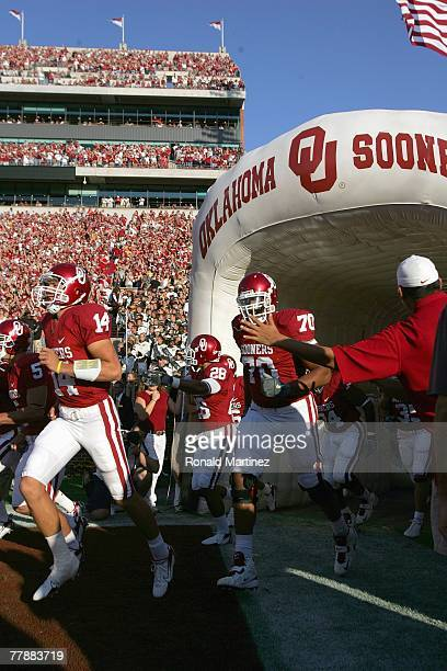 Quarterback Sam Bradford of the Oklahoma Sooners runs out of the tunnel before a game against the Missouri Tigers at Memorial Stadium on October 13...