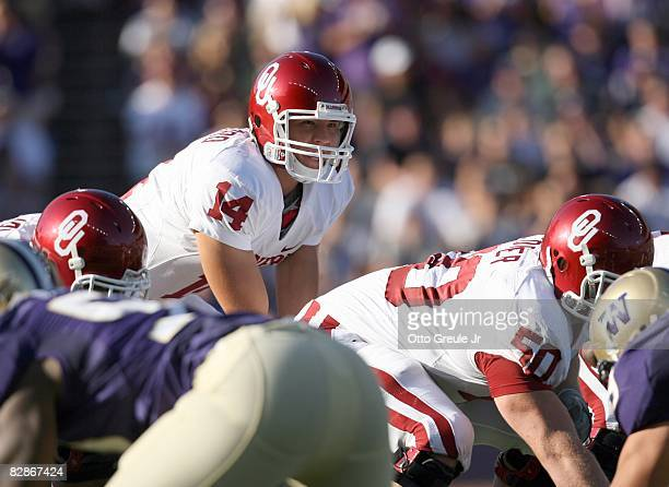 Quarterback Sam Bradford of the Oklahoma Sooners sets up at the line of scrimmage during the game against the Washington Huskies on September 13 2008...