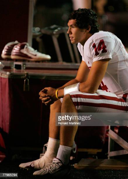 Quarterback Sam Bradford of the Oklahoma Sooners sits on the bench against the Texas Tech Red Raiders in the first quarter at Jones ATT Stadium on...