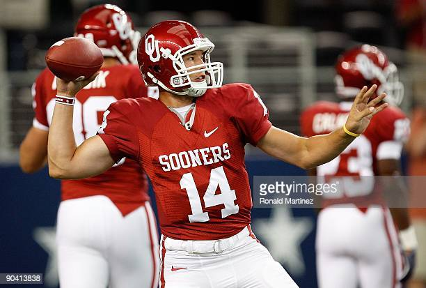Quarterback Sam Bradford of the Oklahoma Sooners warms up before a game against the Brigham Young Cougars at Cowboys Stadium on September 5 2009 in...