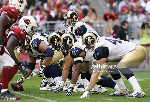 Quarterback Sam Bradford of the St. Louis Rams prepares to snap the ball during the NFL game against the Arizona Cardinals at the University of...