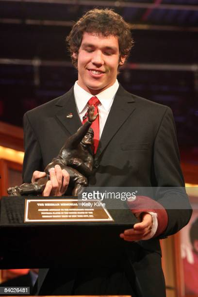 Quarterback Sam Bradford of the University of Oklahoma poses with the Heisman Trophy Bradford was named the 74th Heisman Trophy winner on on December...
