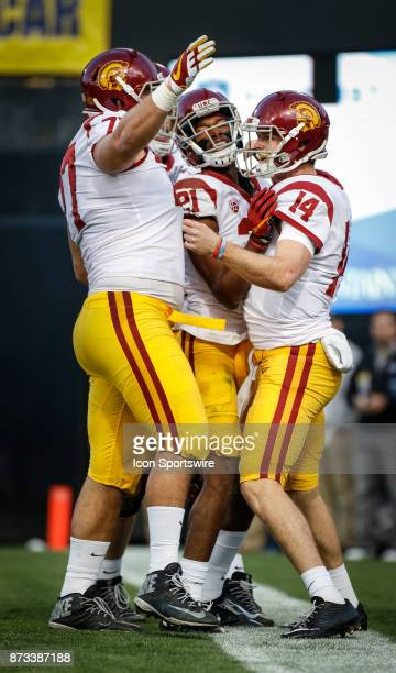 USC quarterback Sam Darnold celebrates with teammates after rushing for a touchdown during the Colorado Buffalos game versus the USC Trojans on...