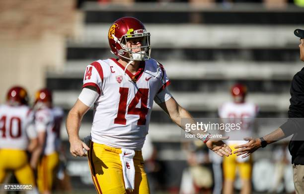 USC quarterback Sam Darnold high fives a coach while running onto the field for warmups before the Colorado Buffalos game versus the USC Trojans on...
