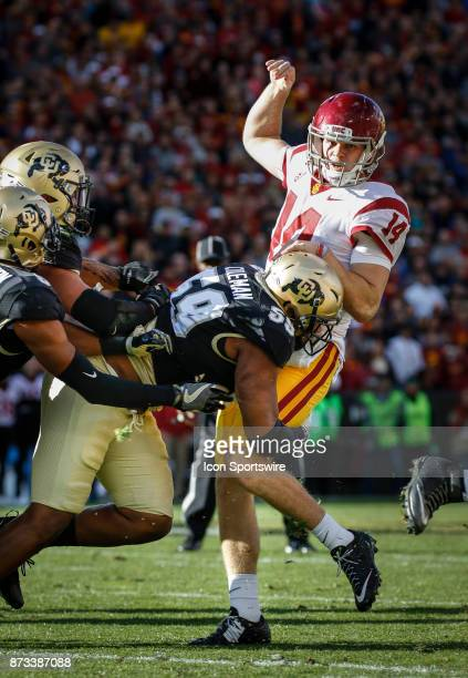 USC quarterback Sam Darnold just gets rid of the ball before being tackled by Colorado's Timothy Coleman Jr #59 during the Colorado Buffalos game...