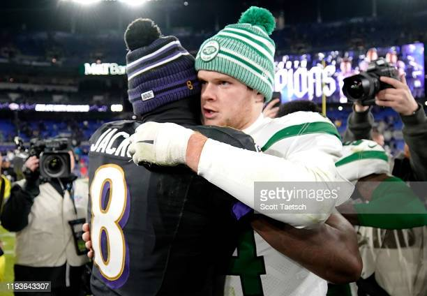 Quarterback Sam Darnold of the New York Jets and quarterback Lamar Jackson of the Baltimore Ravens embrace after their game at MT Bank Stadium on...