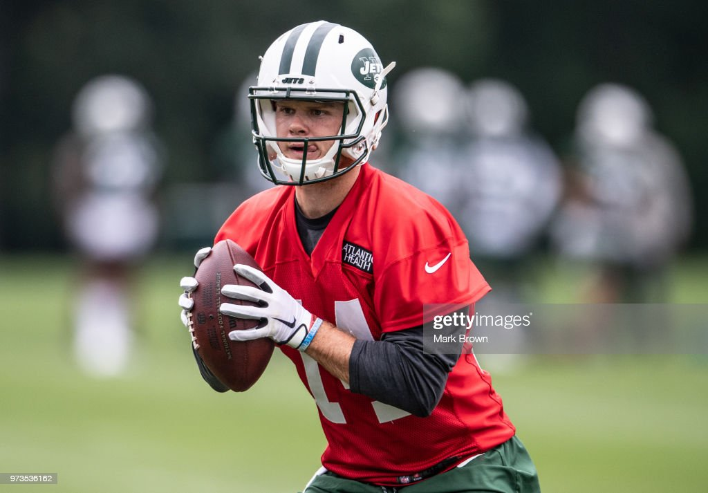 Quarterback Sam Darnold #14 of the New York Jets during team drills at mandatory mini camp on June 13, 2018 at The Atlantic Health Jets Training Center in Florham Park, New Jersey.