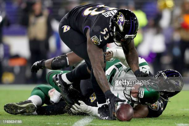 Quarterback Sam Darnold of the New York Jets fumbles and is recovered by defensive end Jihad Ward of the Baltimore Ravens in the third quarter of the...