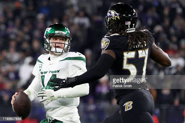 Quarterback Sam Darnold of the New York Jets looks to pass against middle linebacker Josh Bynes of the Baltimore Ravens during the game at M&T Bank...