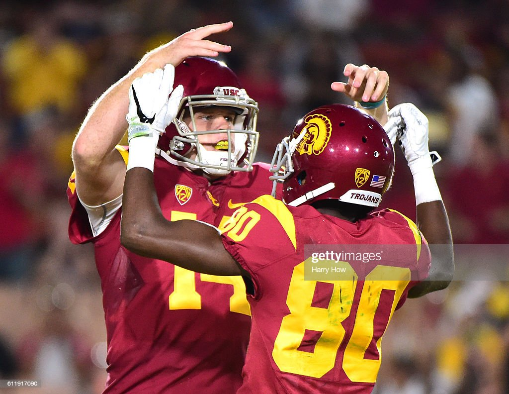 Quarterback Sam Darnold #14 of the USC Trojans celebrates his touchdown with wide receiver Deontay Burnett #80 to take a 41-6 lead over the Arizona State Sun Devils during the third quarter at Los Angeles Coliseum on October 1, 2016 in Los Angeles, California.