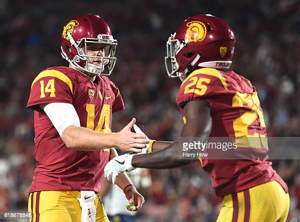 Quarterback Sam Darnold of the USC Trojans celebrates the touchdown of running back Ronald Jones II to take a 140 lead over the California Golden...