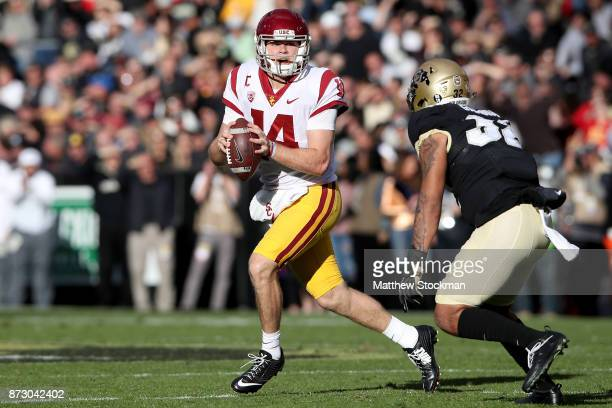 Quarterback Sam Darnold of the USC Trojans is chased out of the pocket by Rick Gamboa of the Colorado Buffaloes at Folsom Field on November 11 2017...