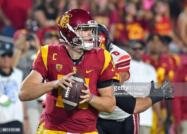 Quarterback Sam Darnold of the USC Trojans passes the ball in the first half of the game against the Utah Utes at the Los Angeles Memorial Coliseum...