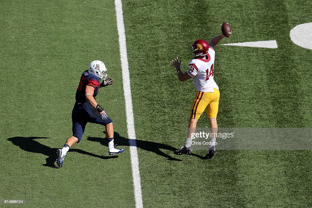 Quarterback Sam Darnold #14 of the USC Trojans throws over linebacker John Kenny #56 of the Arizona Wildcats during the second quarter of the college football game at Arizona Stadium on October 15, 2016 in Tucson, Arizona. USC won 48-14.
