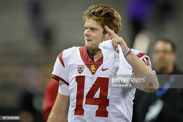 Quarterback Sam Darnold of the USC Trojans waves to the crowd as he heads off the field after beating the Washington Huskies 2413 on November 12 2016...