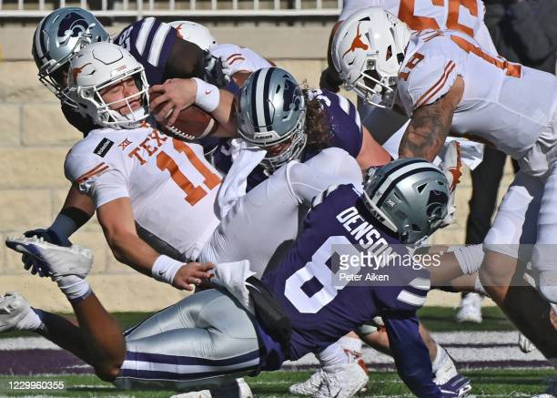 Quarterback Sam Ehlinger of the Texas Longhorns gets tackled for a lose by defensive back Tee Denson of the Kansas State Wildcats, during the first...