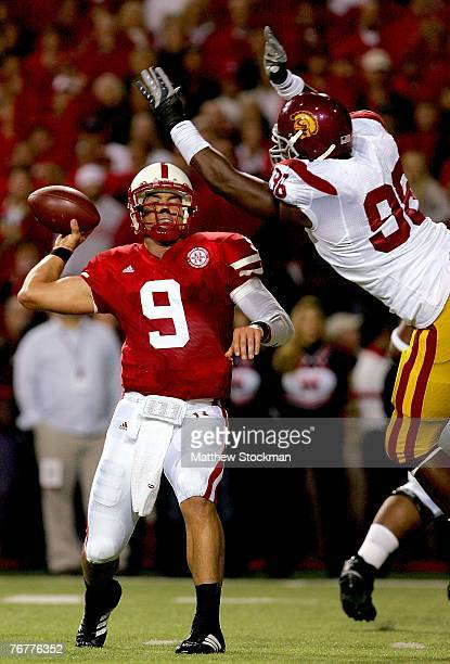 Quarterback Sam Keller of the Nebraska Cornhuskers throws under pressure from DaJohn Harris the USC Trojans on September 15 2007 at Memorial Stadium...