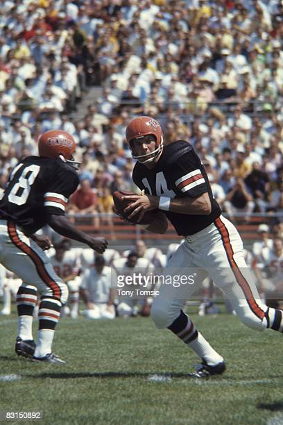 Quarterback Sam Wyche of the Cincinnati Bengals drops back to passl during a preseason game on August 10 1969 against the Boston Patriots in Bowling...