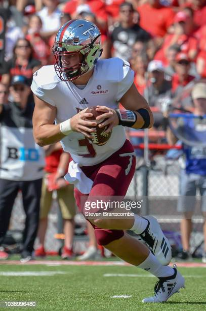 Quarterback Sawyer Smith of the Troy Trojans runs against the Nebraska Cornhuskers at Memorial Stadium on September 15 2018 in Lincoln Nebraska