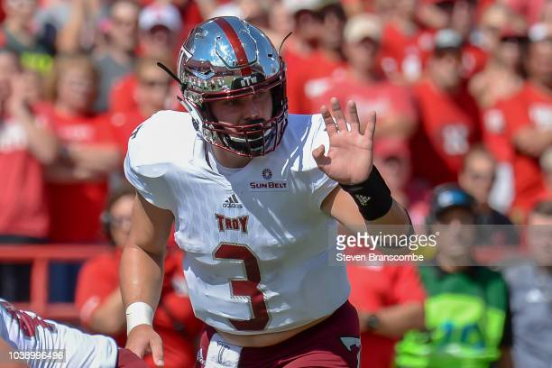 Quarterback Sawyer Smith of the Troy Trojans signals during the game against the Nebraska Cornhuskers at Memorial Stadium on September 15 2018 in...