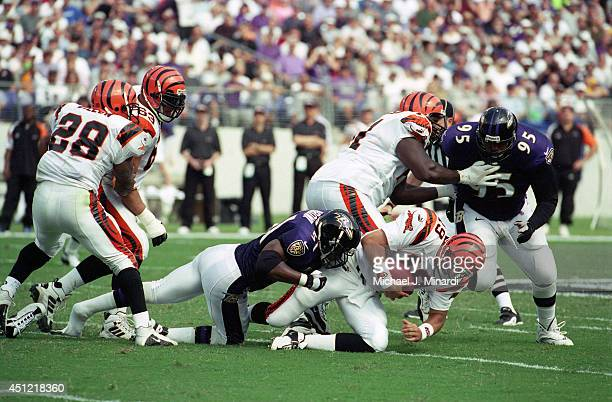 Quarterback Scott Mitchell of the Cincinnati Bengals is sacked by linebacker Cornell Brown of the Baltimore Ravens during a NFL game at PSINet...