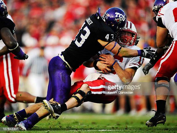 Quarterback Scott Tolzien of the Wisconsin Badgers is sacked by linebacker Tank Carder of the TCU Horned Frogs during the 97th Rose Bowl game on...