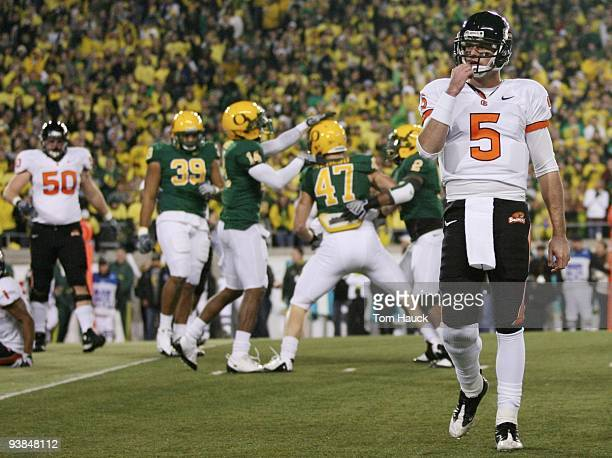 Quarterback Sean Canfield of the Oregon State Beavers walks off the field after teammate Jacquizz Rodgers is tackled by Kiko Alonso of the Oregon...