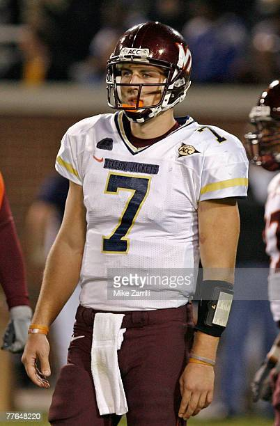 Quarterback Sean Glennon of the Virginia Tech Hokies wears a makeshift team jersey supplied by the Georgia Tech Yellow Jackets jersey during a game...