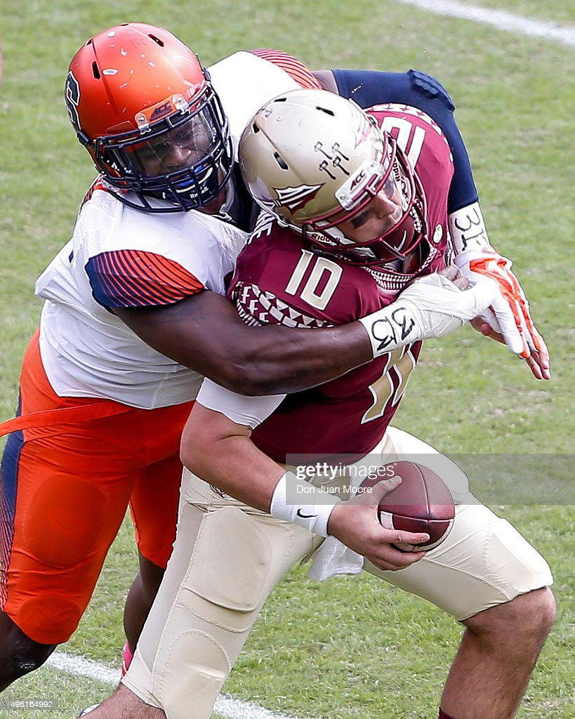 Quarterback Sean Maguire #10 of the Florida State Seminoles is sacked by Defensive End Ron Thompson #13 of the Syracuse Orange during the game at Doak Campbell Stadium on Bobby Bowden Field on October 31, 2015 in Tallahassee, Florida. Florida State defeated Syracuse 45 to 21.