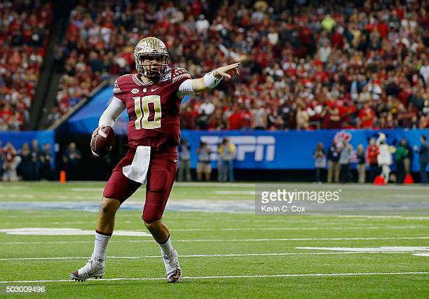 Quarterback Sean Maguire of the Florida State Seminoles rolls out of the pocket in the first quarter against the Houston Cougars during the ChickfilA...