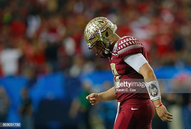 Quarterback Sean Maguire reacts after throwing an interception in the third quarter against the Houston Cougars during the ChickfilA Peach Bowl at...