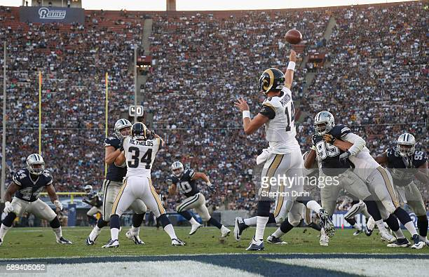 Quarterback Sean Mannion of the Los Angeles Rams throws a pass against the Dallas Cowboys at the Los Angeles Coliseum during preseason on August 13...