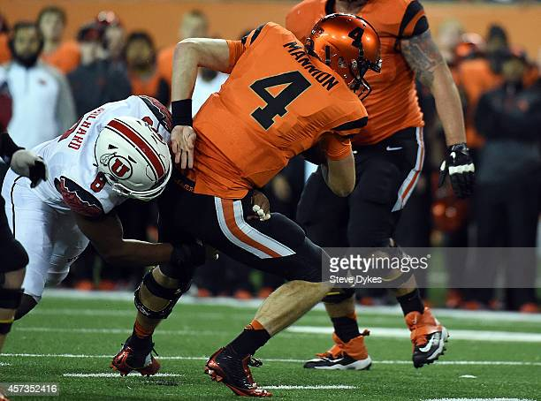 Quarterback Sean Mannion of the Oregon State Beavers is sacked by defensive end Nate Orchard of the Utah Utes in the second overtime of the game at...
