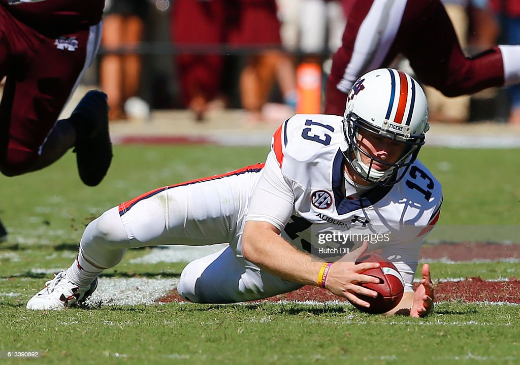 Quarterback Sean White #13 of the Auburn Tigers dives to recover a fumble against the Mississippi State Bulldogs during the second half of an NCAA college football game on October 8, 2016 in Starkville, Mississippi. Auburn won 38-14.