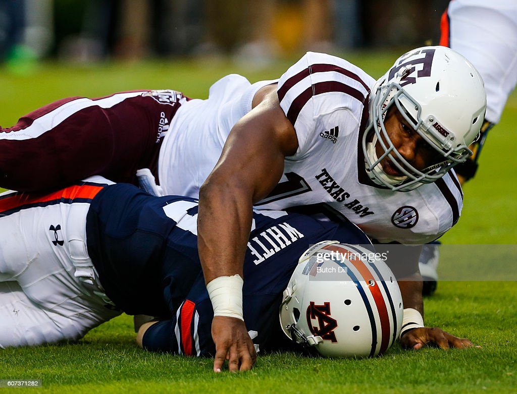 Quarterback Sean White #13 of the Auburn Tigers is sacked by defensive lineman Myles Garrett #15 of the Texas A&M Aggies during an NCAA college football game on September 17, 2016 in Auburn, Alabama.