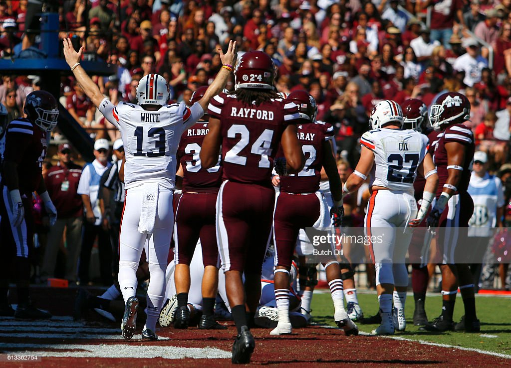 Quarterback Sean White #13 of the Auburn Tigers signals a touchdown as the Auburn Tigers score against the Mississippi State Bulldogs during the first half of an NCAA college football game on October 8, 2016 in Starkville, Mississippi.