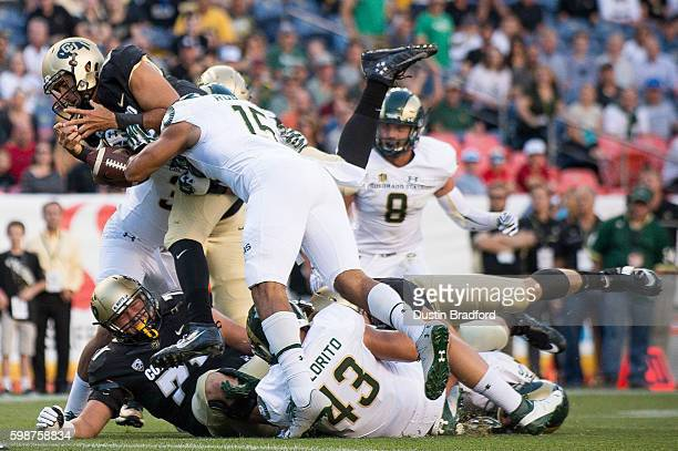 Quarterback Sefo Liufau of the Colorado Buffaloes loses the football after crossing the goal line in the first quarter of a game against the Colorado...