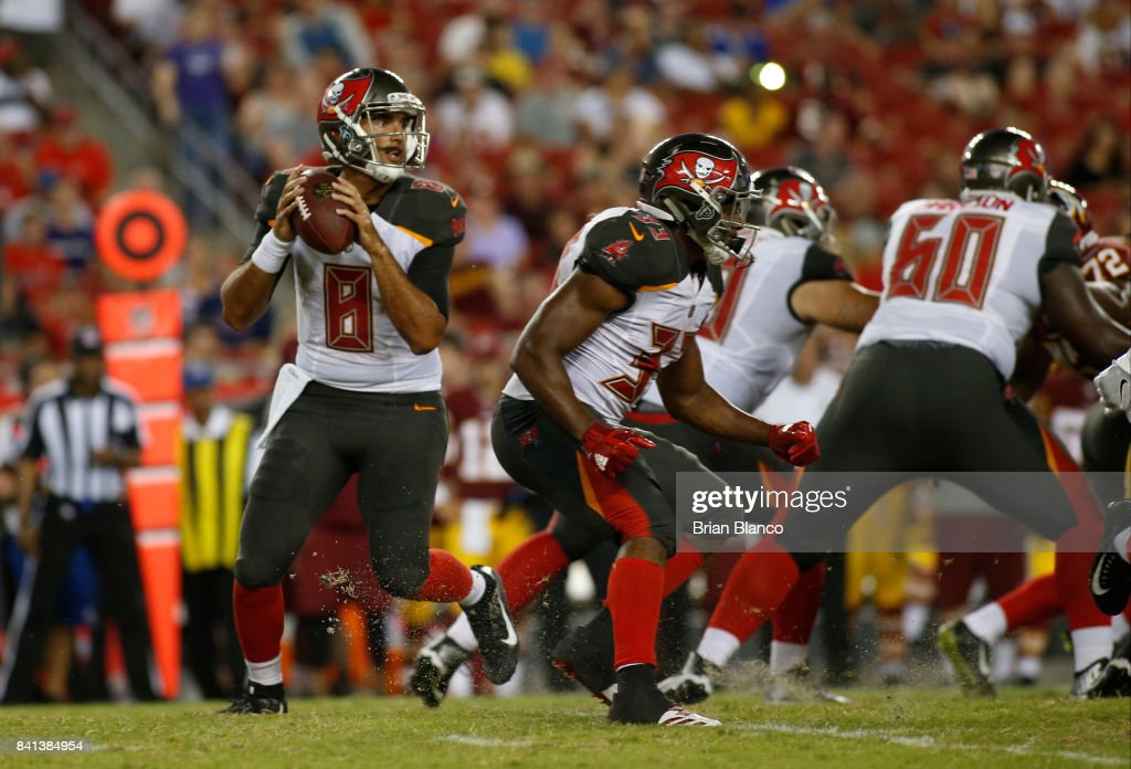 Quarterback Sefo Liufau #8 of the Tampa Bay Buccaneers looks for an open receiver during the third quarter of an NFL preseason football game against the Washington Redskins on August 31, 2017 at Raymond James Stadium in Tampa, Florida.