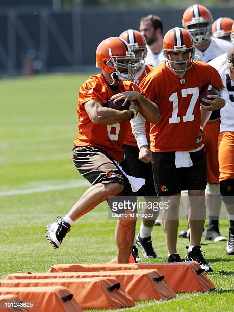 Quarterback Seneca Wallace of the Cleveland Browns performs an agility drill during the team's organized team activity on May 27 2010 at the...