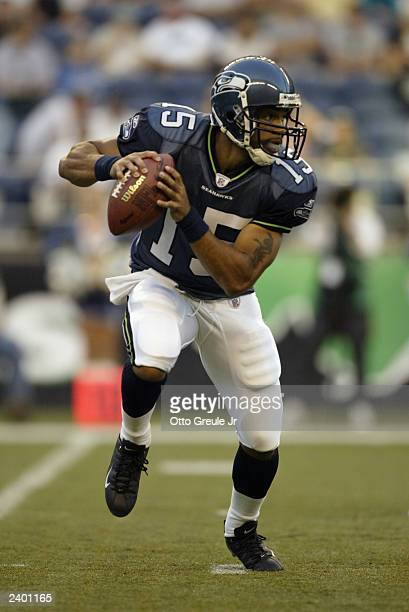 Quarterback Seneca Wallace of the Seattle Seahawks drops back to pass against the San Diego Chargers during the NFL preseason game at Seahawks...