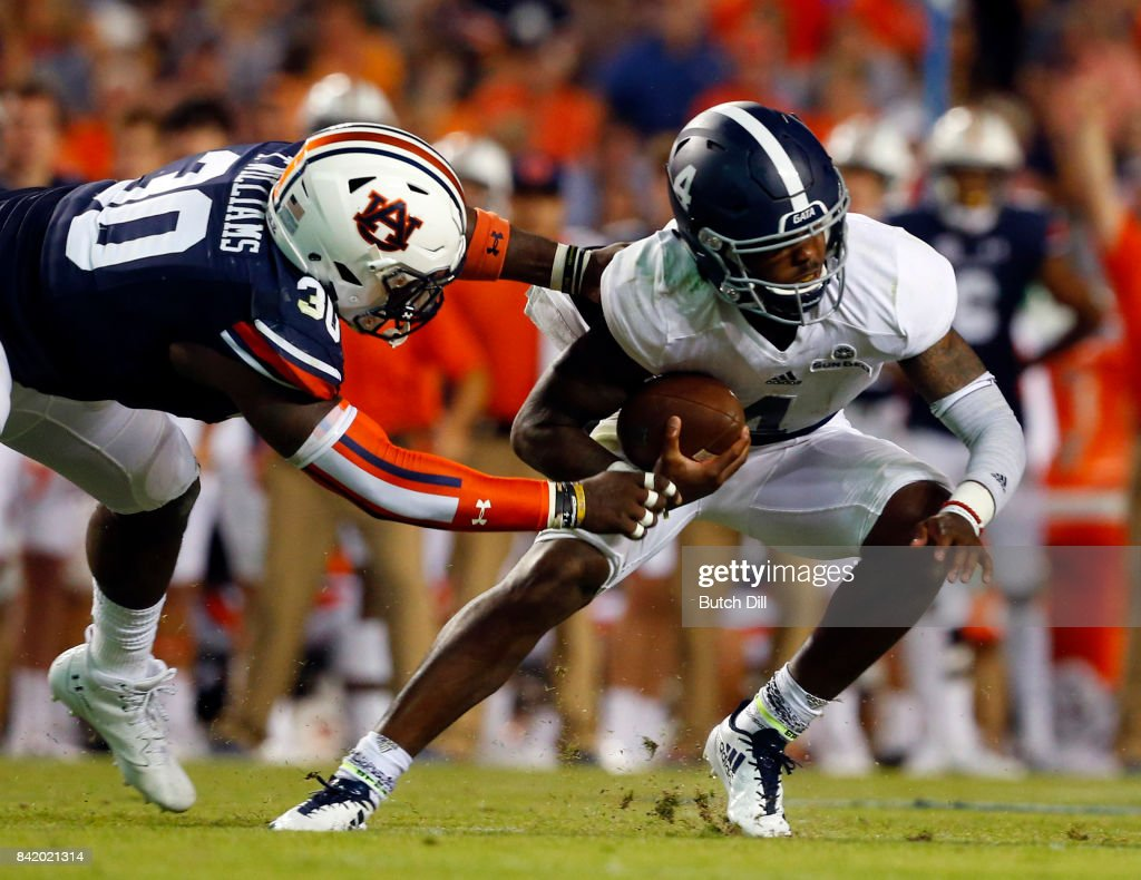 Quarterback Shai Werts #4 of the Georgia Southern Eagles is sacked by linebacker Tre' Williams #30 of the Auburn Tigers during the second half of an NCAA college football game at Jordan Hare Stadium on Saturday, September 2, 2017 in Auburn, Alabama.
