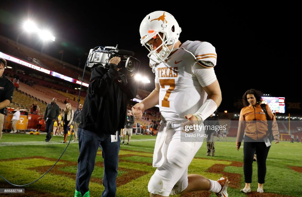 Quarterback Shane Buechele #7 of the Texas Longhorns exits the field after defeating the Iowa State Cyclones 17-7 at Jack Trice Stadium on September 28, 2017 in Ames, Iowa. The Texas Longhorns won 17-7 over the Iowa State Cyclones.