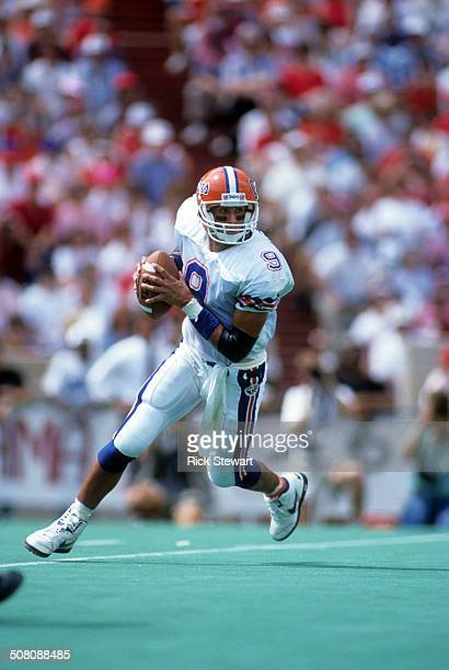 Quarterback Shane Matthews of the Florida Gators runs with the ball during a game against the Alabama Crimson Tide on September 15, 1990 at...