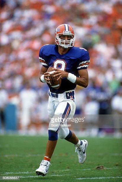 Quarterback Shane Matthews of the Florida Gators runs with the ball during a game against the Mississippi State Bulldogs on September 29 1990 at Ben...
