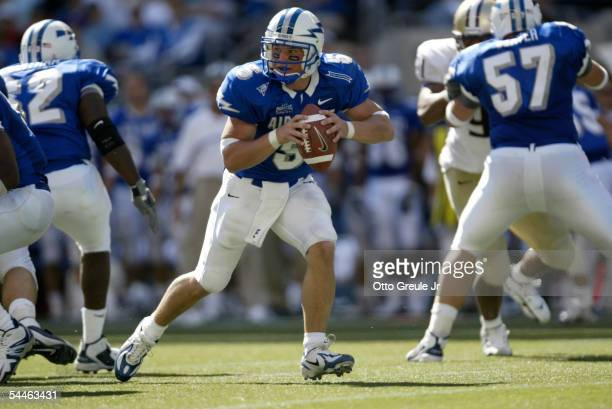 Quarterback Shaun Carney of Air Force rolls out to pass against the Washington Huskies on September 3 2005 at Quest Field in Seattle Washington