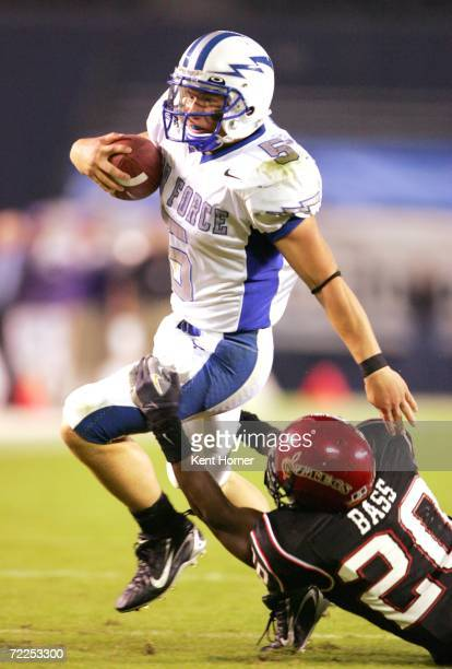 Quarterback Shaun Carney of the Air Force Falcons runs with the ball against Ray Bass of the San Diego State Aztecs on October 21 2006 during their...